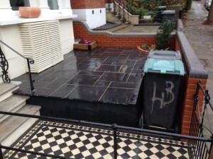 Victorian tiles , black limestone ,wooden services box , brickwork